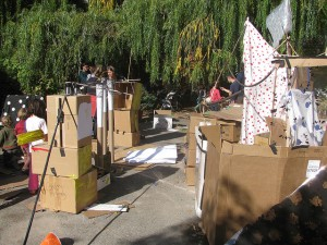 build a cardboard city, play with cardboard boxes, host a box party, Bring Your Own Box party, let kids build with cardboard,